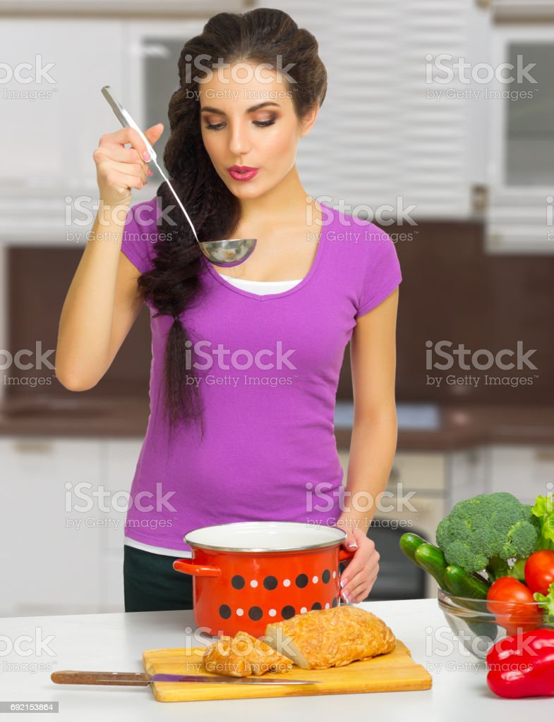 Young cooking woman stock photo