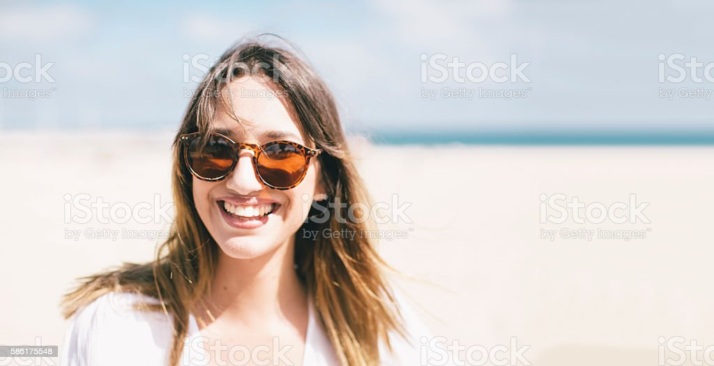 Young cool beautiful and with attitude looking at camera headshot stock photo