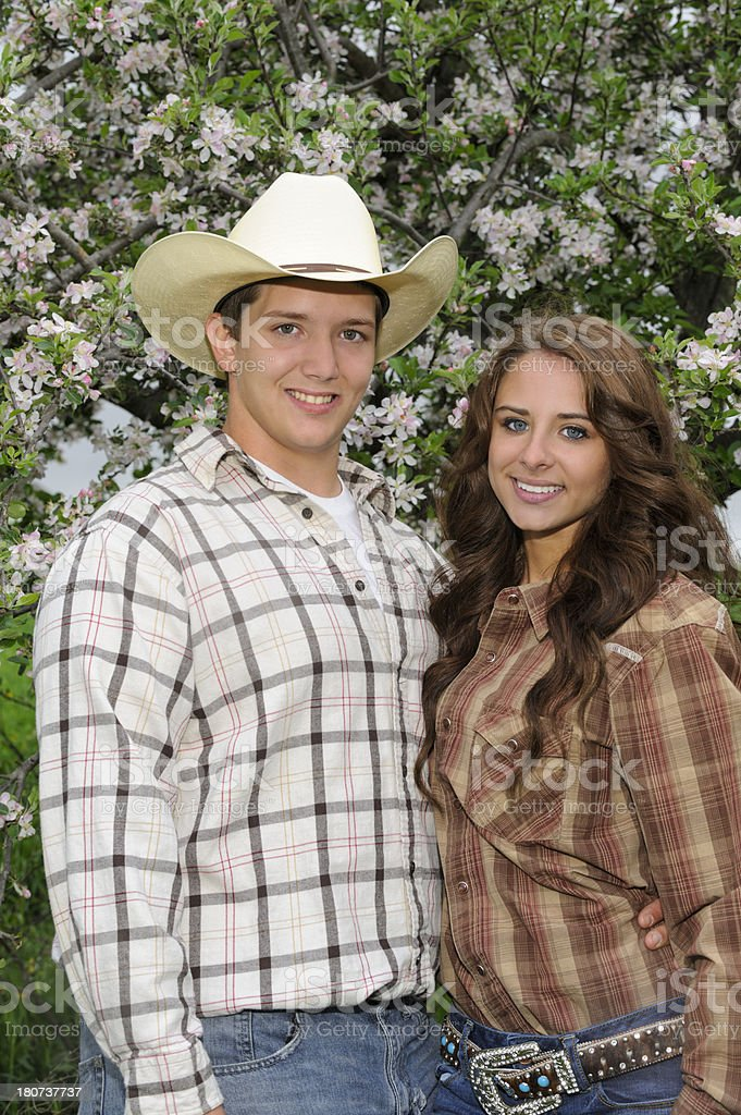 Young Country Couple in Western Clothing, Attractive Young Americans royalty-free stock photo