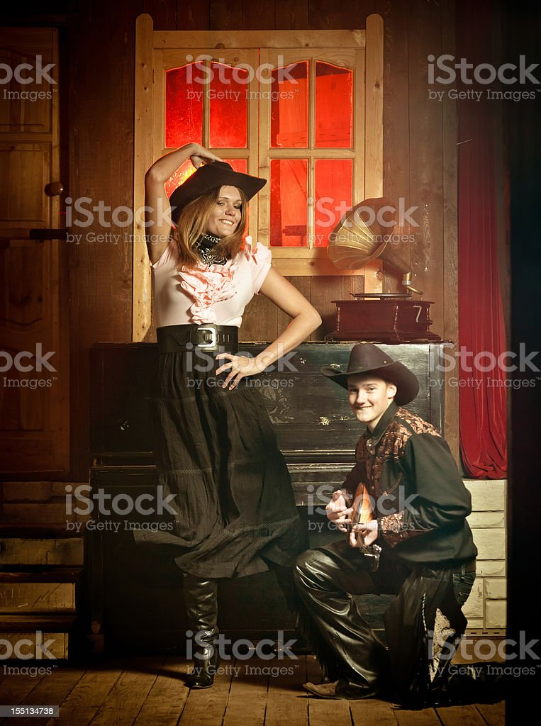 Young country western couple dancing in saloon stock photo