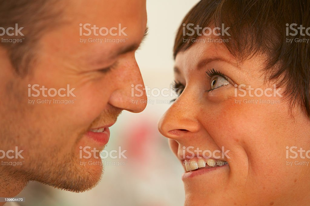 Young couple about to kiss royalty-free stock photo