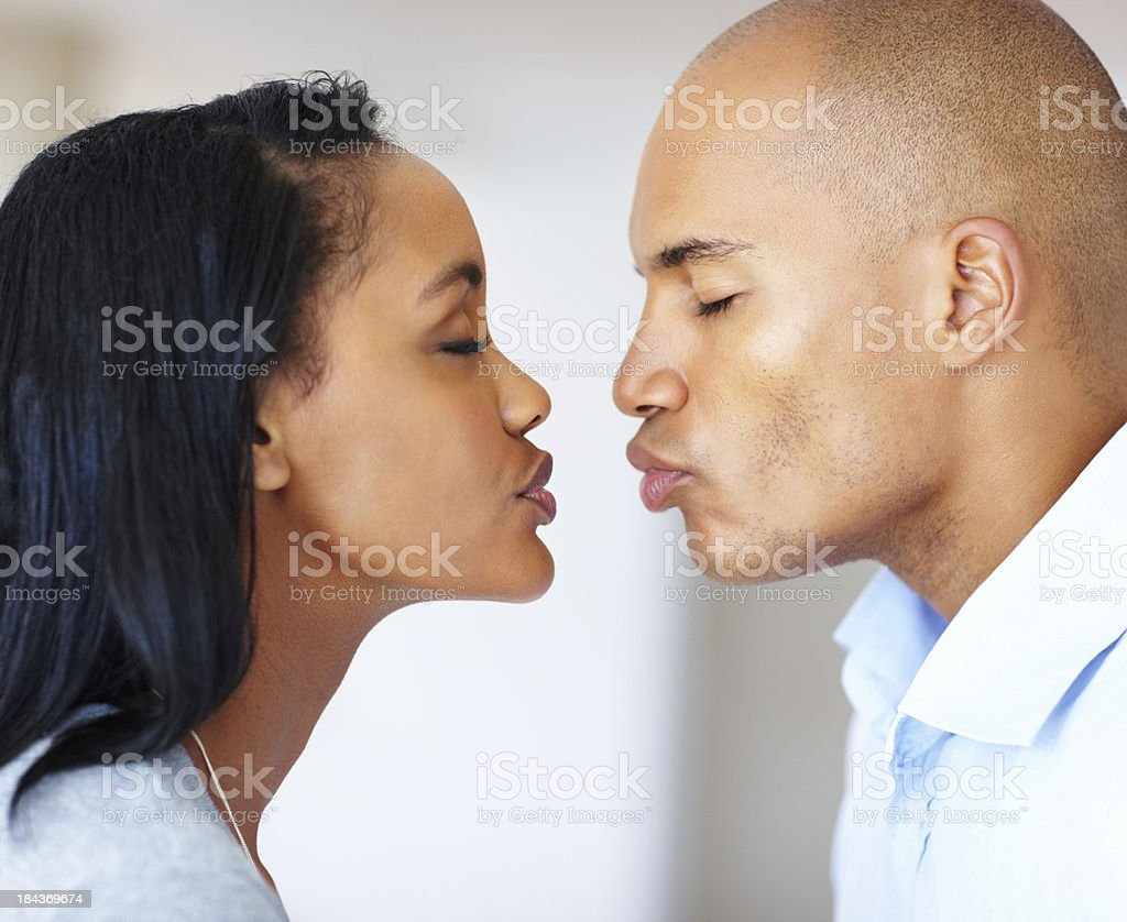 Young couple about to kiss stock photo