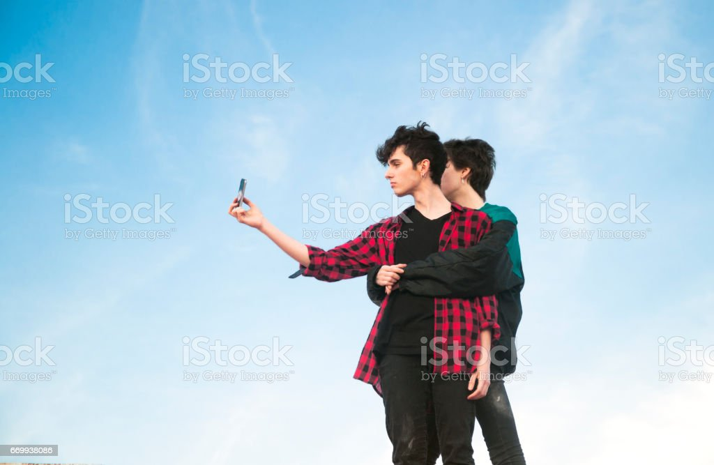 young couple above the city stock photo