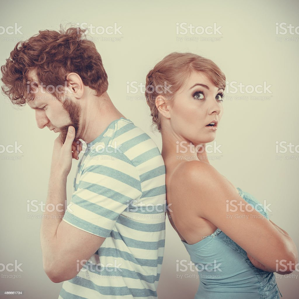 Young couple after quarrel offended back to back stock photo