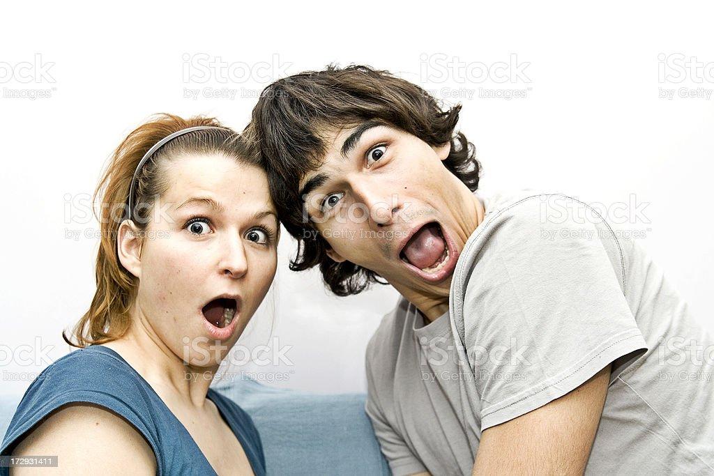 Young couple - AMAZEMENT, SURPRISE stock photo