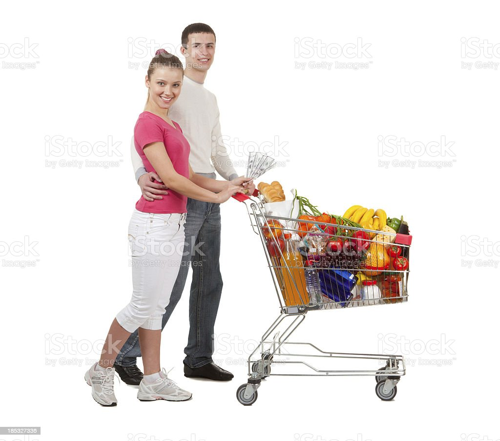 Young Couple And  Shopping Trolley of Food. royalty-free stock photo