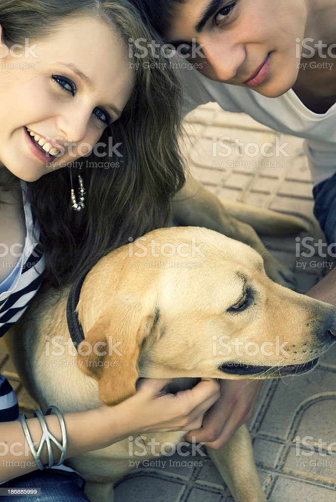 Young couple and sweet dog royalty-free stock photo