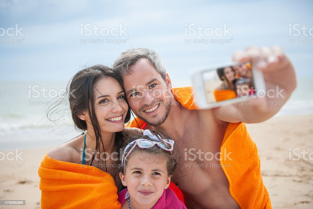 Young couple and their daughter taking a selfie stock photo