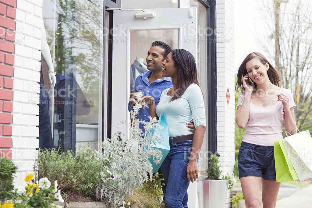 Young Couple and Woman Shopping royalty-free stock photo