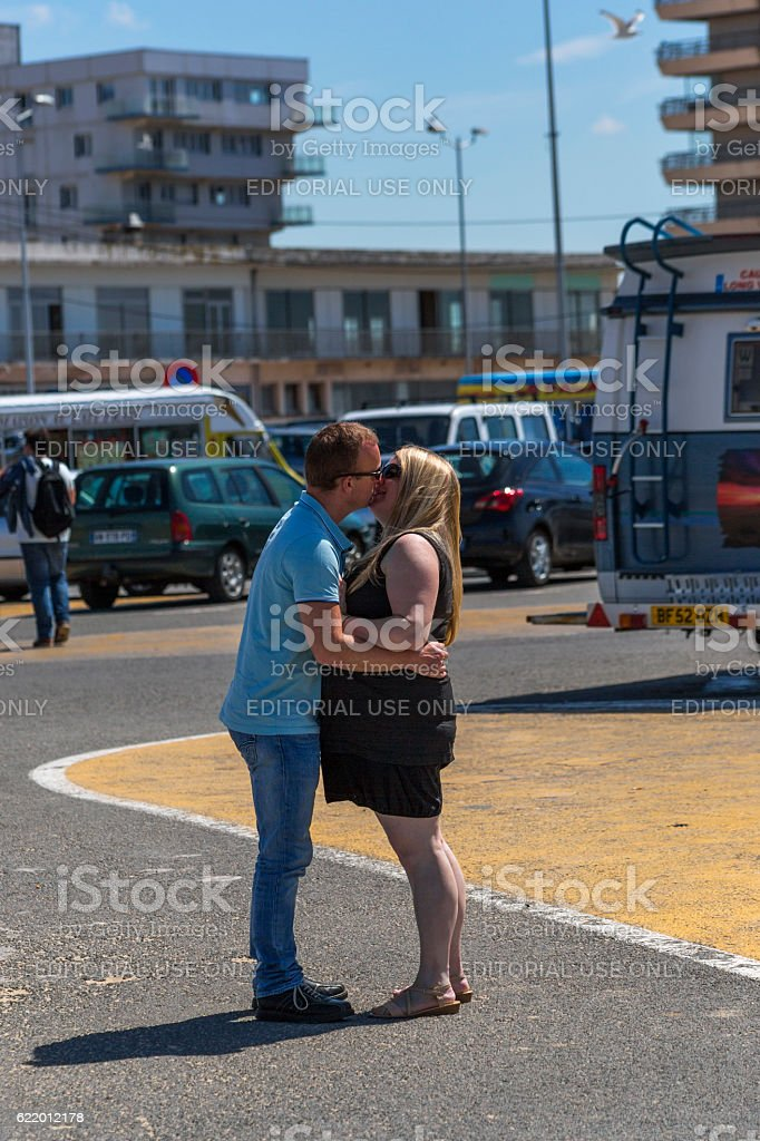 Young couple are hugging and kissing eachother at calais france stock photo