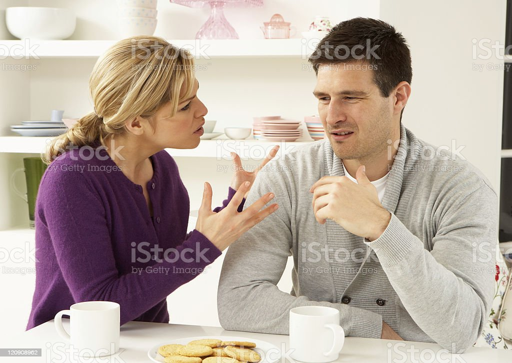 Young couple arguing at home over coffee stock photo