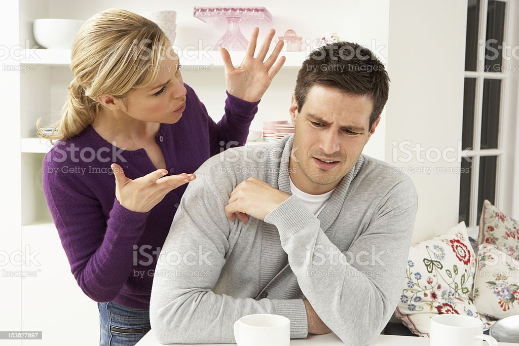 Young couple arguing in their home stock photo