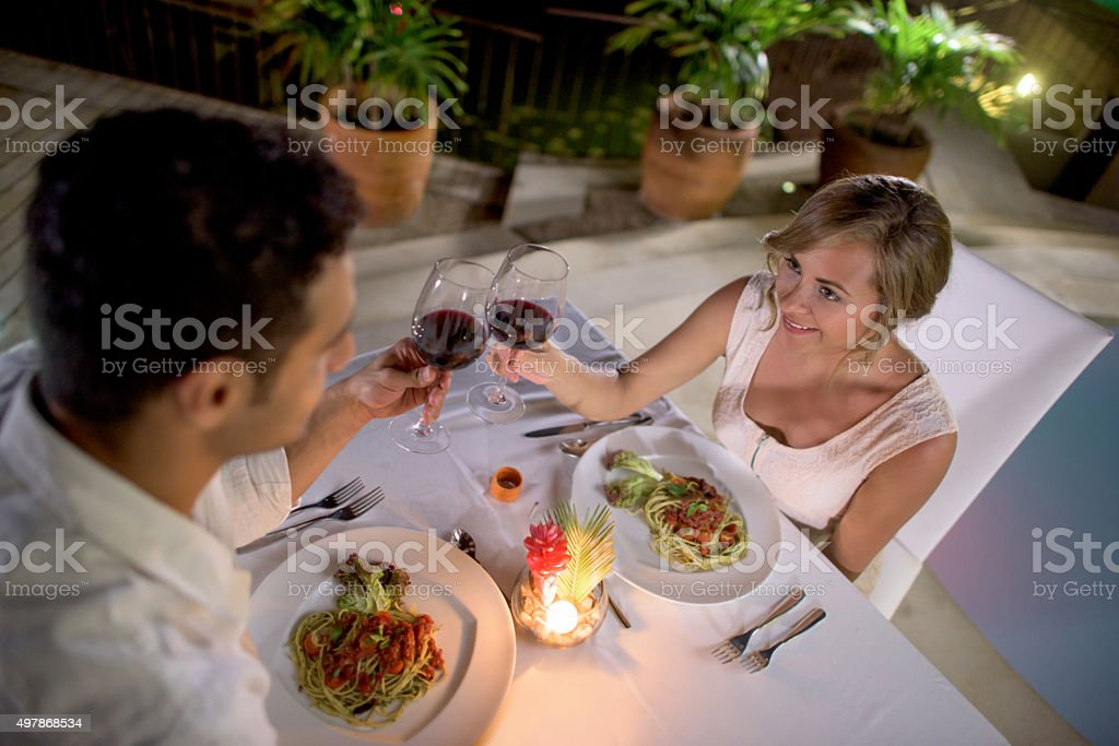 Young couple at a romantic dinner stock photo