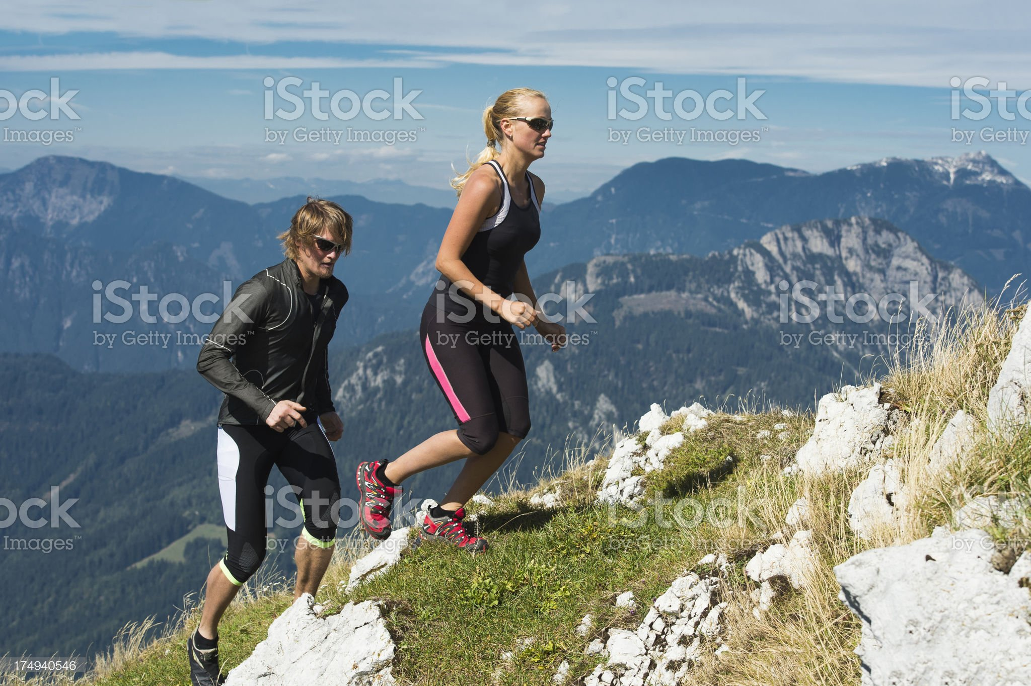 Young couple at alpine run royalty-free stock photo