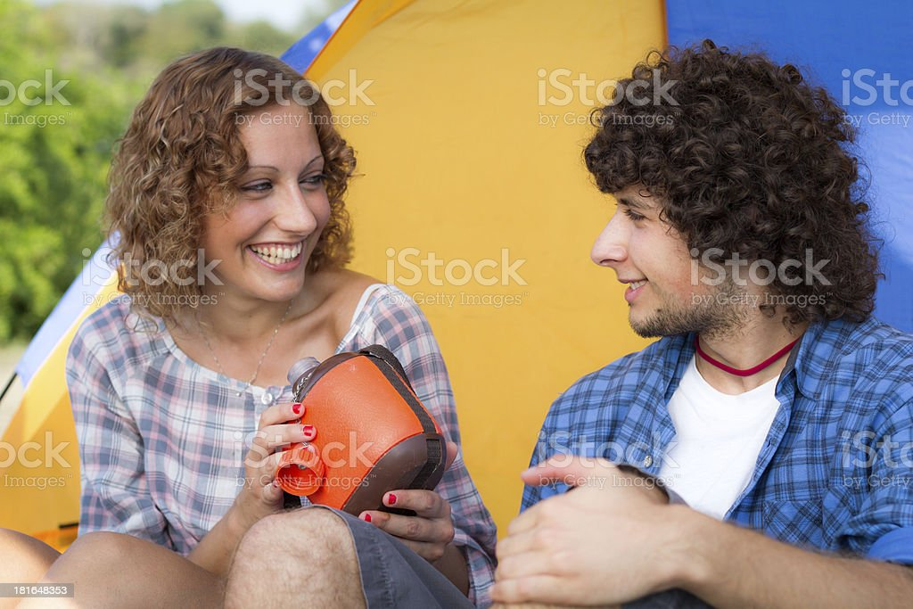 Young couple at camping with water canteen royalty-free stock photo