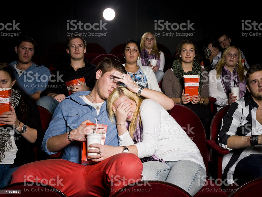 Young couple at cinema royalty-free stock photo