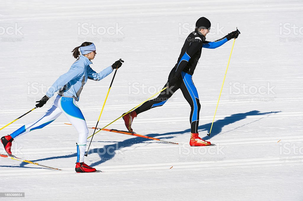 Young couple at cross country skiing stock photo