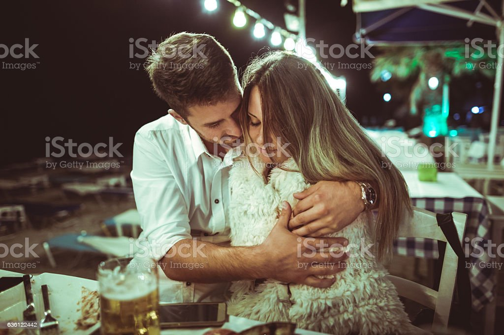 Young couple at dinner stock photo
