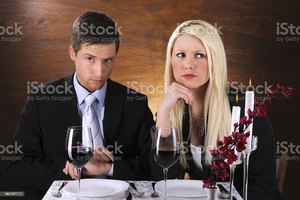 Young couple at dinner with negative expression royalty-free stock photo