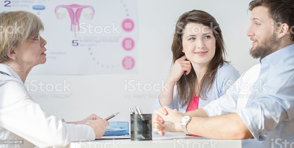Young couple at gynecological office stock photo