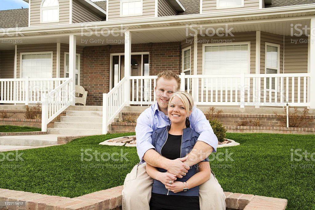 Young Couple at Home in Front Yard royalty-free stock photo