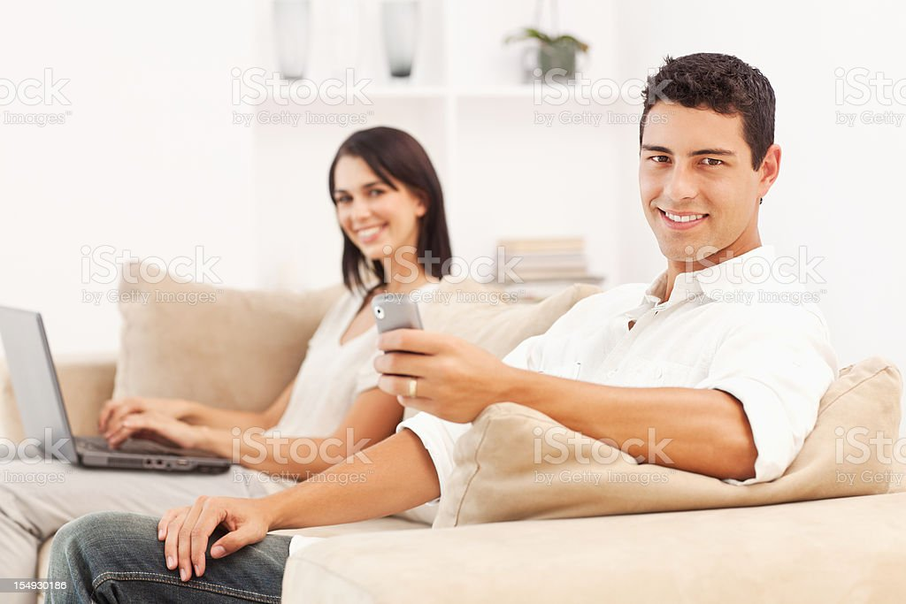 Young Couple at Home on the Couch royalty-free stock photo