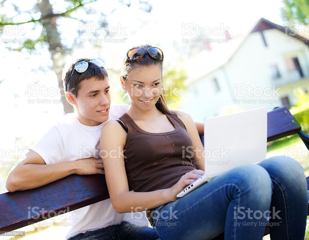 Young couple at park royalty-free stock photo