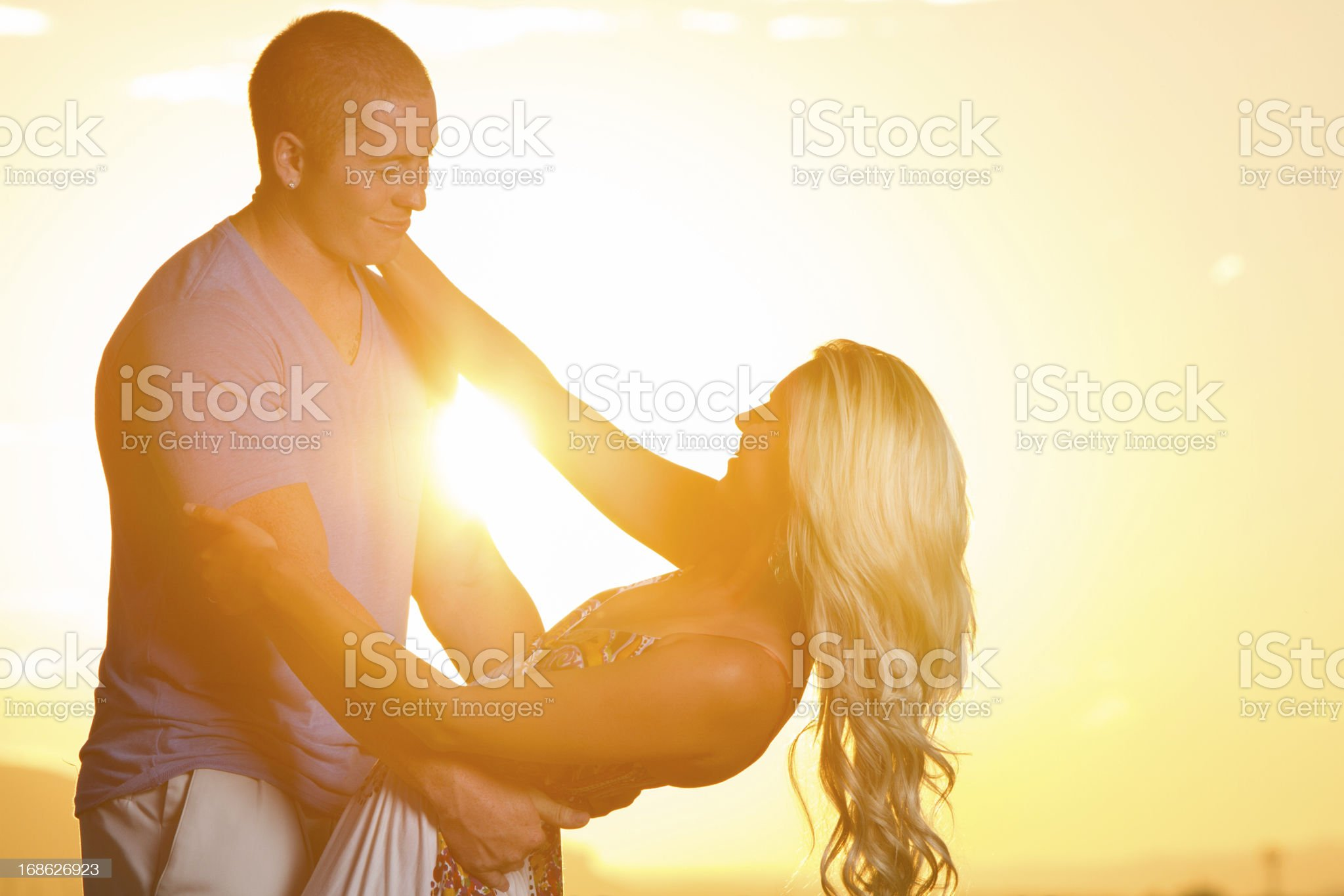 Young Couple at Sunset royalty-free stock photo