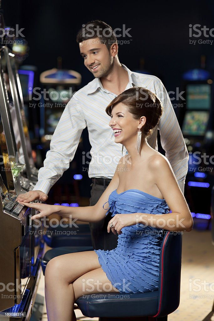 young couple at the casino royalty-free stock photo