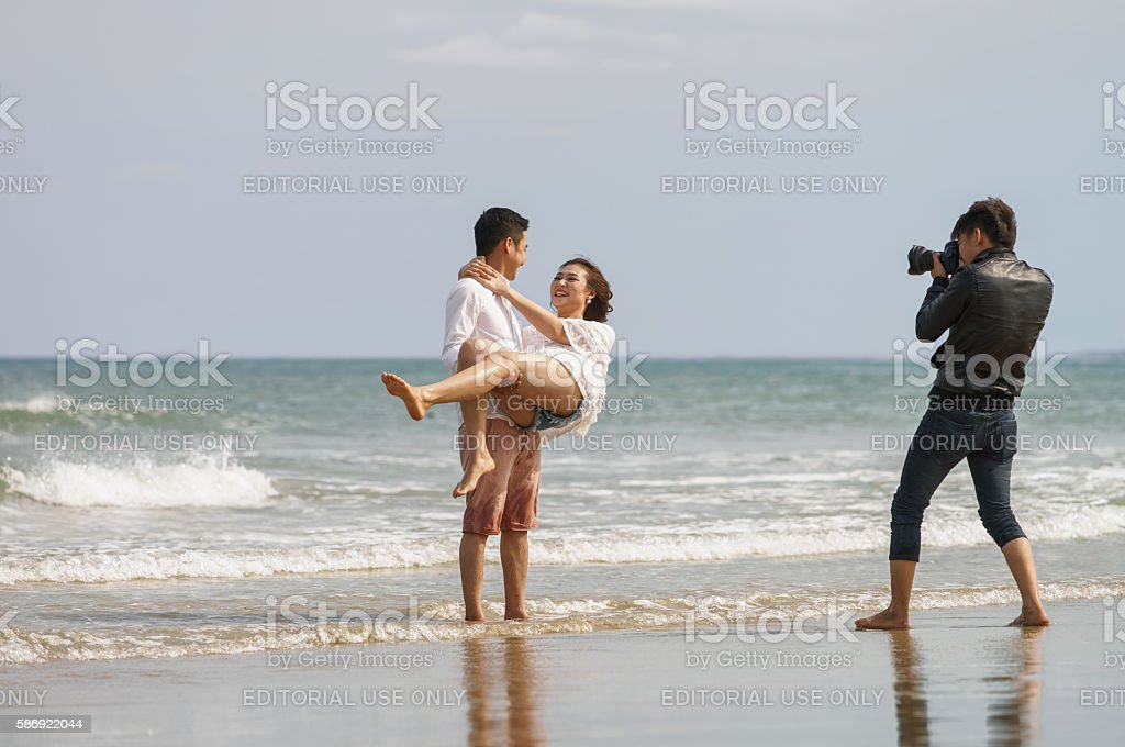 Young couple  at the China Beach in Danang Vietnam stock photo