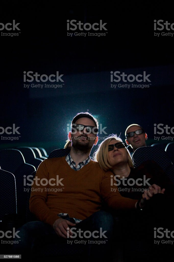 Young couple at the cinema watching movie stock photo