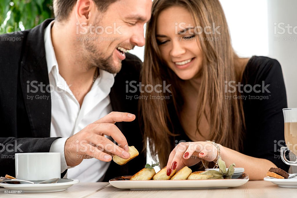 Young couple at the restaurant stock photo