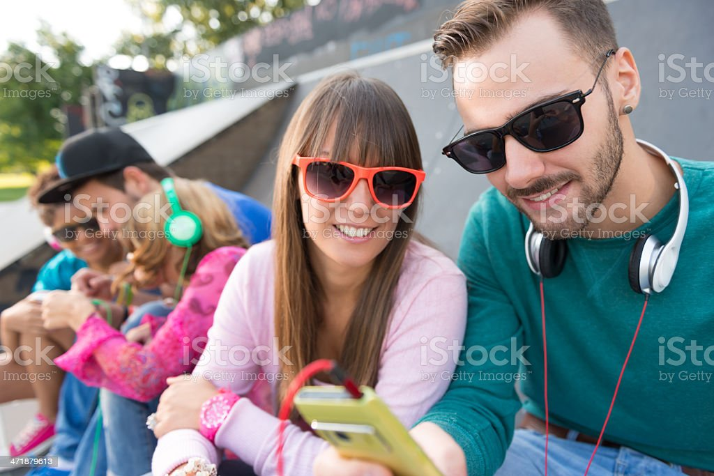 Young couple at the skatepark royalty-free stock photo