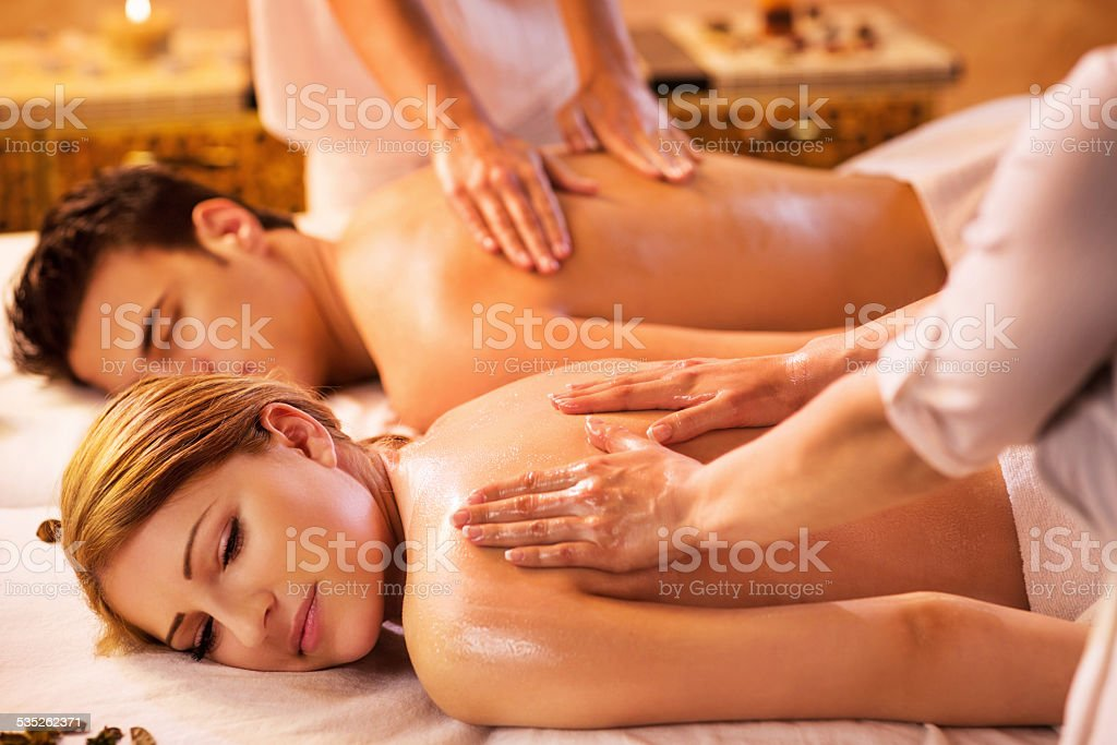 Young couple at the spa. stock photo
