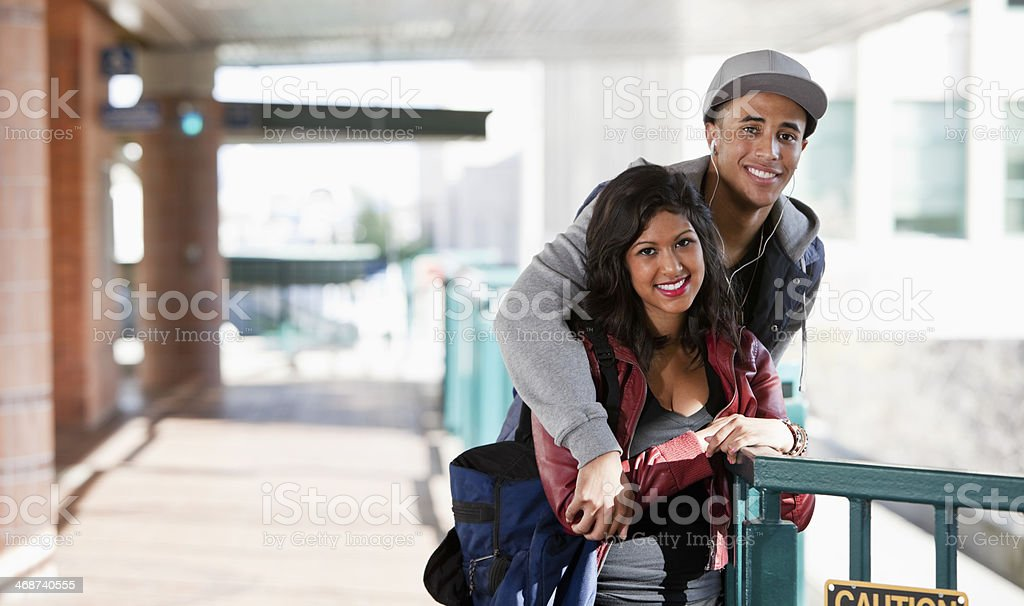 Young couple at train station stock photo