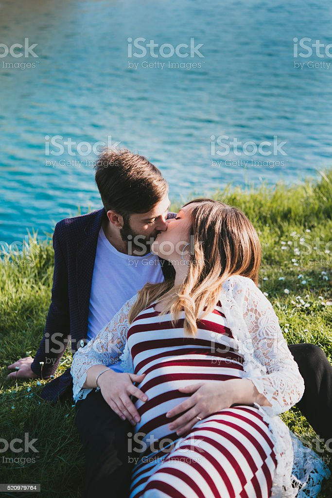 young couple attended child outdoor stock photo