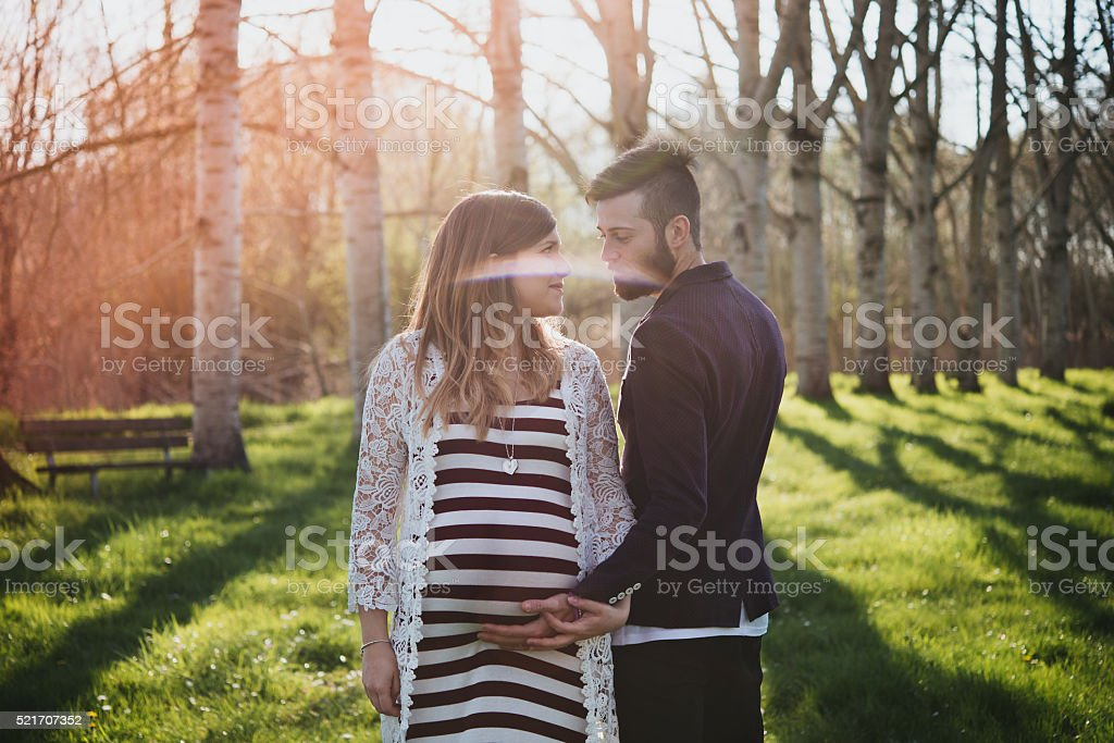 young couple attended child, outdoor stock photo