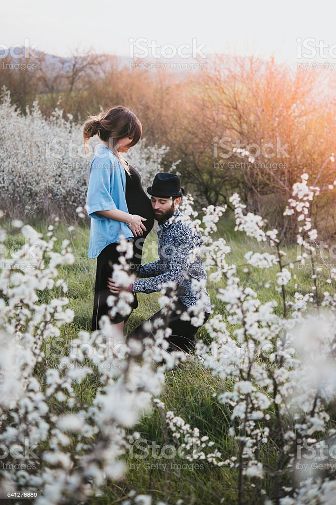 young couple attended child, outdoor, spring stock photo