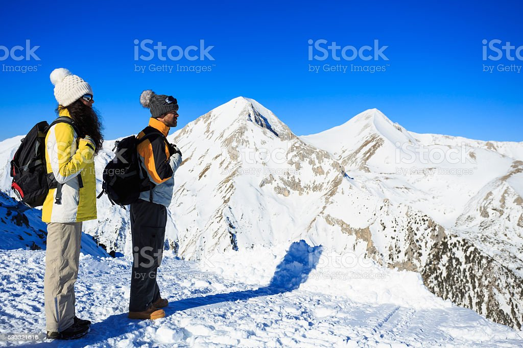 Young couple backpackers hiking in the mountain stock photo