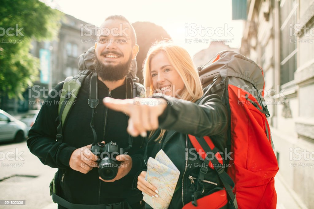 Young Couple Backpackers in the city stock photo