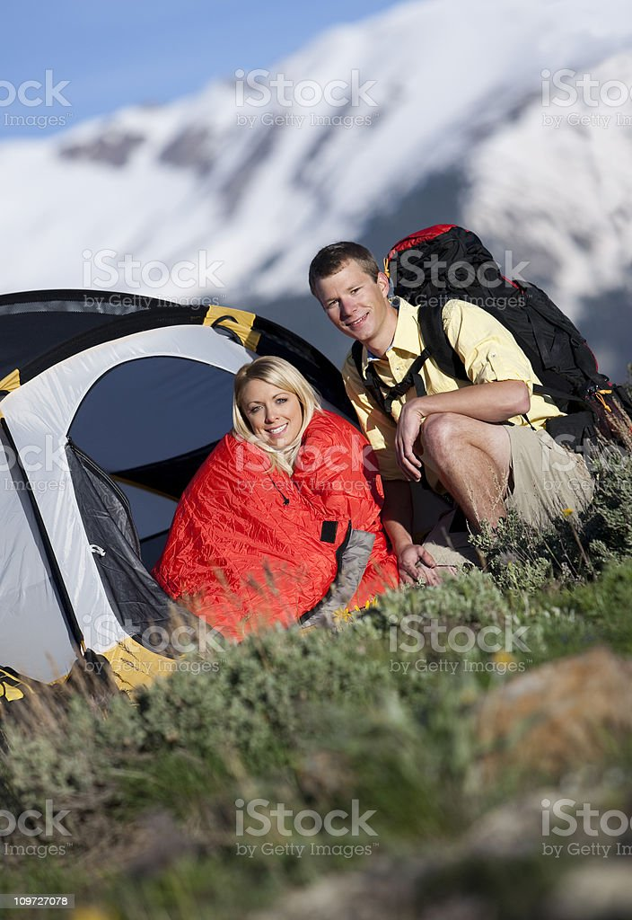 Young Couple Backpacking And Camping In the Rocky Mountains royalty-free stock photo