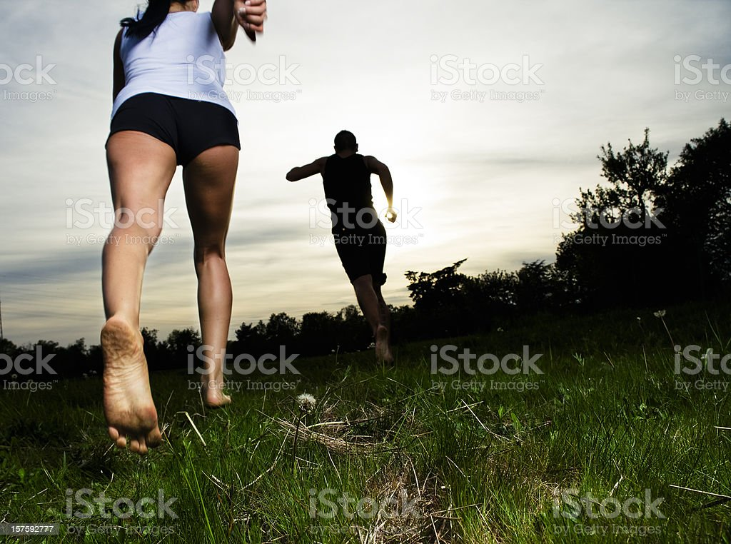 Young Couple Barefoot Running stock photo