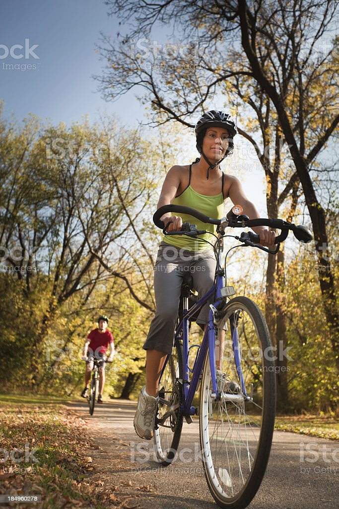 Young Couple Bicyclists Exercising in Autumn for Healthy Lifestyle stock photo