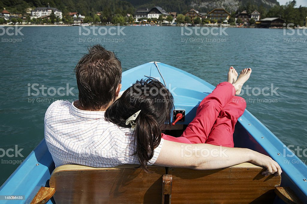 young couple boating on the lake royalty-free stock photo