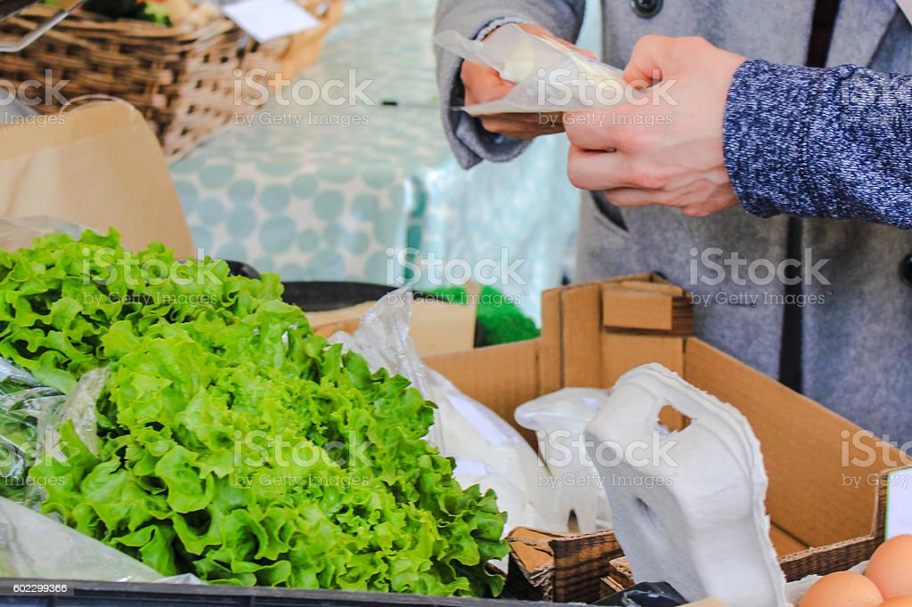 Young couple buying a cheese in a groceries store stock photo