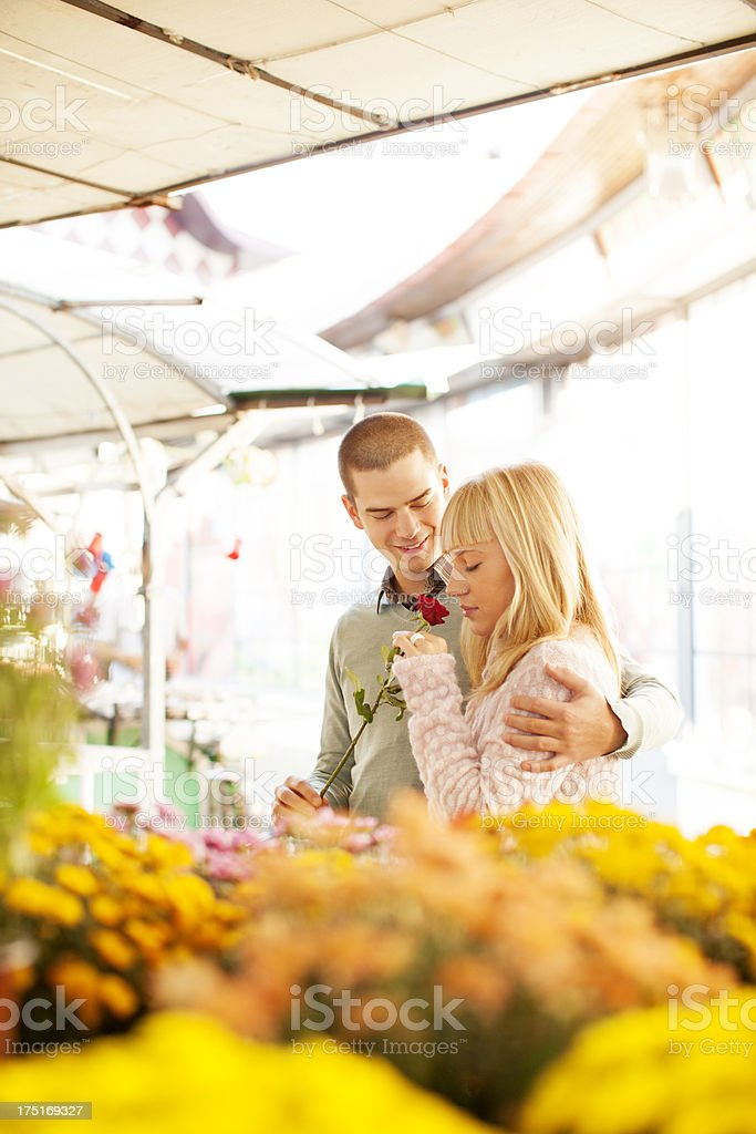 Young Couple Buying Flowers. royalty-free stock photo