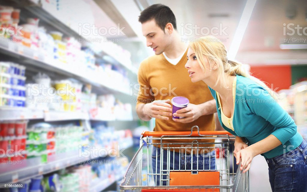 Young couple buying food in supermarket. stock photo