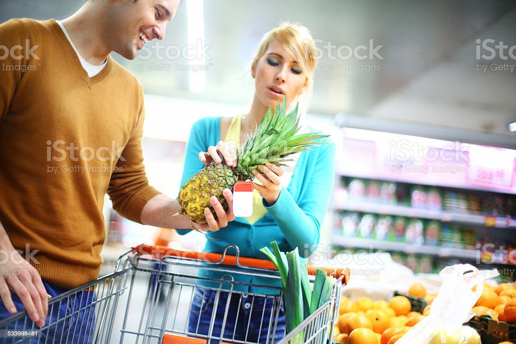Young couple buying fruits in supermarket. stock photo