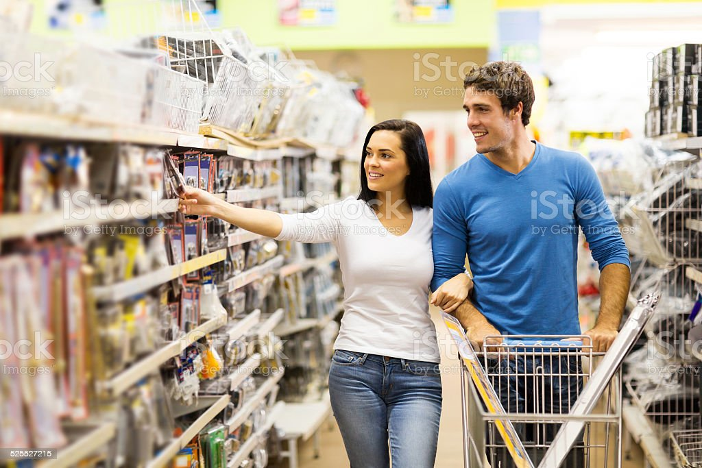 young couple buying padlock stock photo