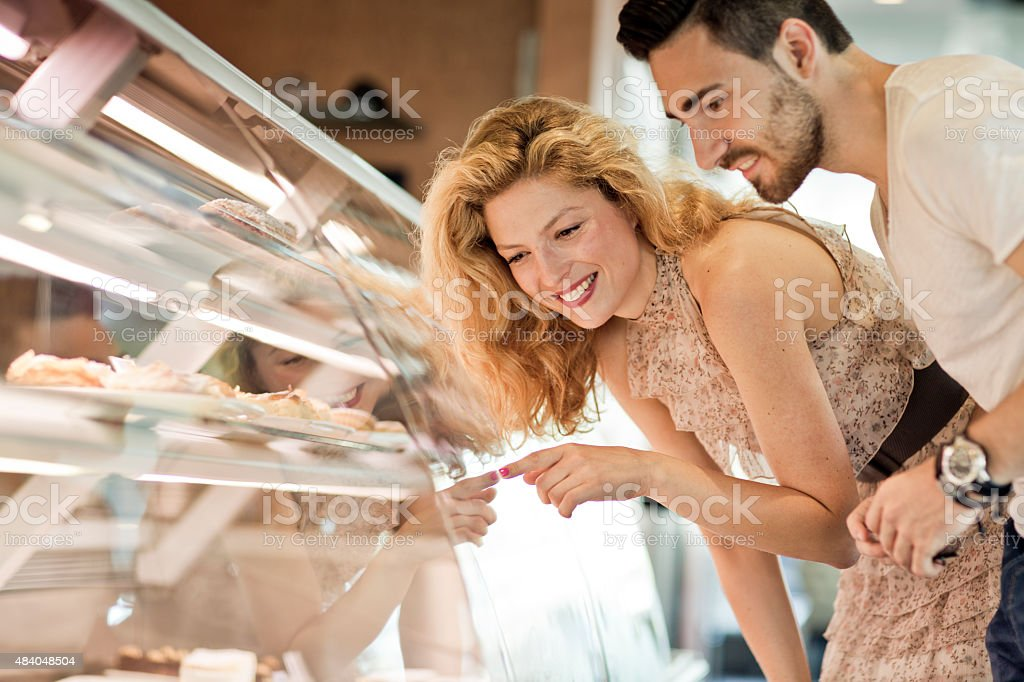 Young  couple buying sweets in pastry shop stock photo